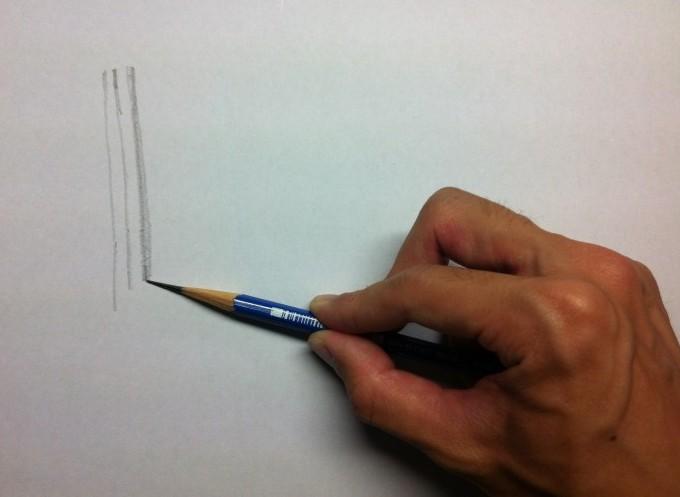 鉛筆を寝かせて縦の線を描く